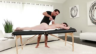 Oiled Keira Croft gets her pussy banged by a dude on the massage table
