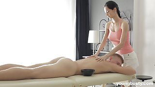 Slender masseuse with big tits Emma L gets intimate with one of her clients